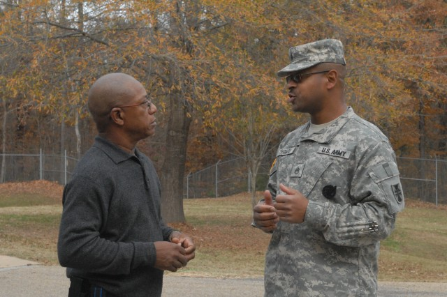 Staff Sgt. Jason Thomas, Career Counselor, shares his views about the comand's safety program and USARC's new ReportIt system with Charlie Foreman, 412TEC Safety Manager, Dec. 9, 2011 at the George A. Morris Army Reserve Center in Vicksburg, Miss. (Photo: Capt. Maryjane Porter)