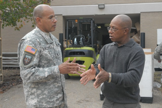 Charlie Foreman, 412TEC Safety Manager, and Sgt. 1st Class Orlando Fontenez, Maintenance NCO, discuss new USARC requirements and the way forward for the command's safety program Dec. 9, 2011 at the George A. Morris Army Reserve Center in Vicksburg, Miss. (Photo: Capt. Maryjane Porter)