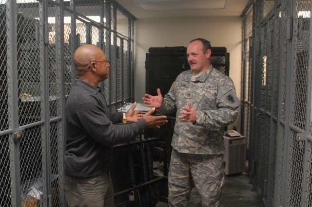 Staff Sgt. David L. Putnam, Supply NCO, updates Charlie Foreman, 412TEC Safety Manager, about the status of safety measures implemented for the Supply and Arms Room Dec. 9, 2011 at the George A. Morris Army Reserve Center in Vicksburg, Miss. (Photo: Capt. Maryjane Porter)