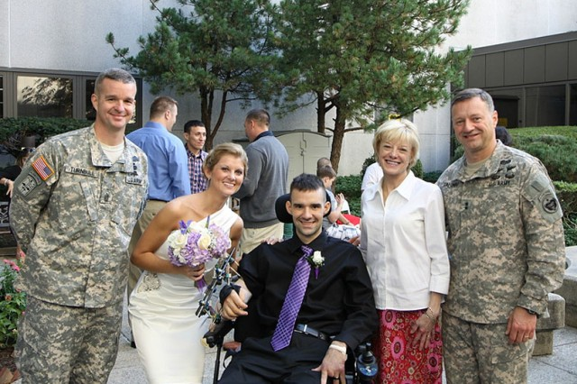Newlyweds Sgt. Davin and Dana Dumar pose with surprise wedding guests: U.S. Army Commanding General, Raymond Palumbo and his wife Alice; and USARAK Command Sgt. Maj. David Turnbull, Oct. 8 at Walter Reed Army Medical Center. (Courtesy photo)