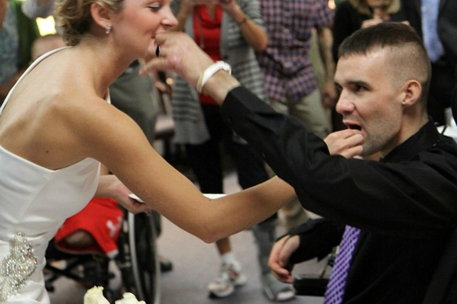 Dana and Sgt. Davin Dumar share in a bite of their wedding cake during Oct. 8 nuptials at Walter Reed Army Medical Center. (Courtesy photo)