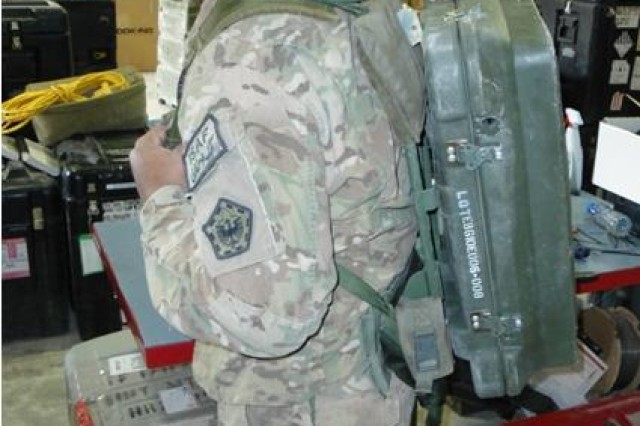 Specialist William Morgan, with the 571st Engineer Company, displays his new backpack edition, carrying case for the T-Hawk UAV system.  The new case was developed by Soldiers and the T-Hawk field service representatives to help ease space constraints inside the Soldiers' tactical vehicles.