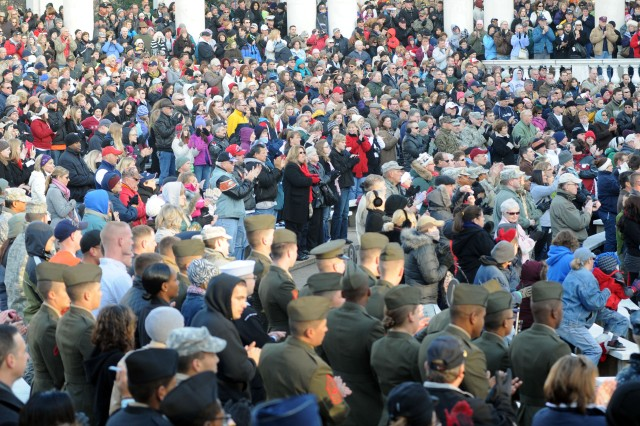 Thousands of volunteers showed to lay 85,000 wreaths at grave stones in Arlington National Cemetery, Dec. 10, 2011, as part of the 20th annual Wreaths Across America event.