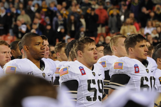 As is tradition, Army players sing the U.S. Military Academy's alma mater following their 10th consecutive loss to the Naval Academy 27-21 at FedEx Field Dec. 10, 2011.