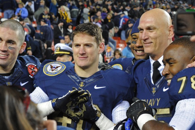 Army Chief of Staff Raymond T. Odierno shows his sportsmanship by donning a Navy jersey after Army lost it's 10th consecutive football game to the Midshipmen of Annapolis at FedEx Field Dec. 10, 2011.