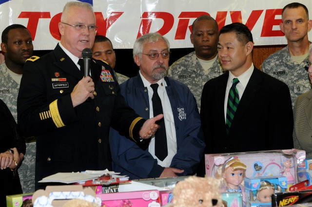 Brig. Gen. Douglas R. Satterfield, deputy commanding general of the 412th Theater Engineer Command, from Vicksburg, Miss., accepted nearly 600 donated toys on behalf of the Army while attending a presentation at New York Hospital Queens on December 9.