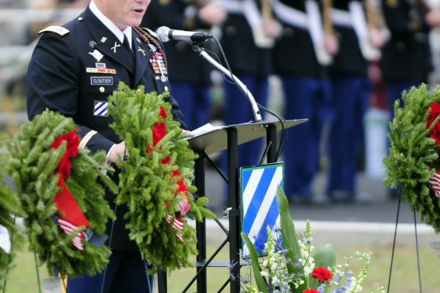 Col. Roger Cloutier, deputy commanding general-manuever, speaks in front of friends and families of fallen Third Infantry Division Soldiers before they placed wreaths at their trees along Warrior's Walk, Dec. 10, 2011, at Fort Stewart, Ga.