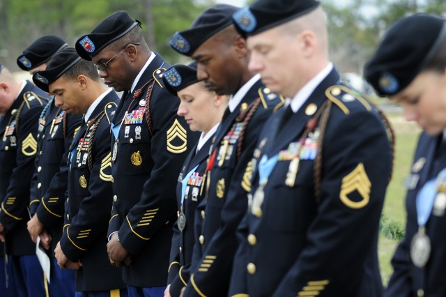 Soldiers bow their head in prayer during the benediction at the Quick Track during Wreaths for Warriors Walk, Dec. 10, 2011, at Fort Stewart, Ga.