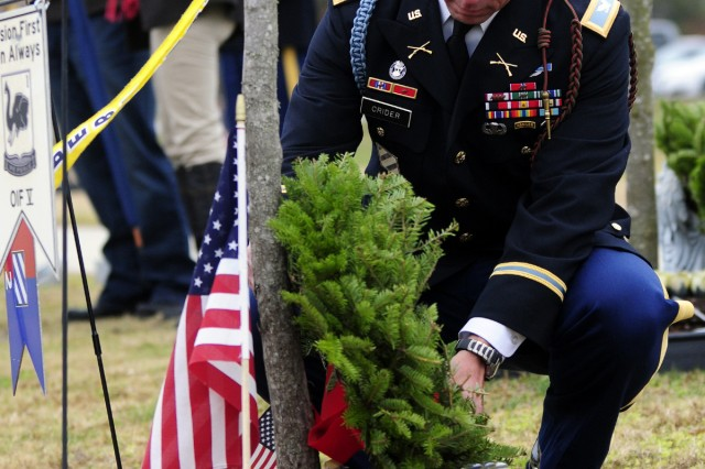 Col. Jim Crider, 1st Heavy Brigade Combat Team commander, places a wreath at Maj. Sid Brookshire's tree during Wreaths for Warriors Walk, Dec. 10, 2011.