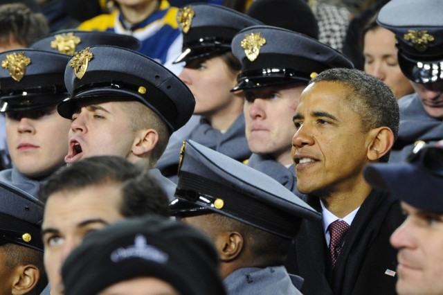 President Barack Obama switched to the Army side of the field to root with the cadets following half-time at the 112th meeting with Navy. Army lost in a hard-fought game to Navy for the 10th consecutive time, 27-21.
