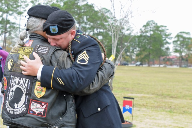 Two men embrace, Dec. 10, 2011, during the Wreaths for Warriors Walk Wreath Ceremony in Honor of the Fallen Heroes of the 3rd Infantry Division at Cottrell Field on Fort Stewart, Ga.