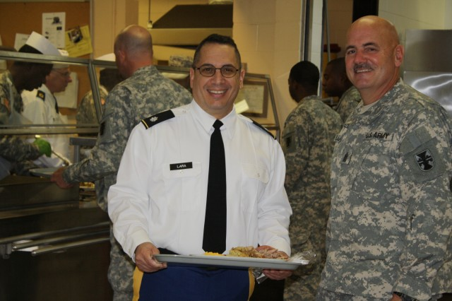 Lt. Col. Felipe Lara Jr and Command Sgt. Maj. Ronald Flubacher, 412th Theater Engineer Command, enjoy Christmas dinner during Family Day Dec. 11, 2011 at the George A. Morris Army Reserve Center in Vicksburg, Miss. (Photo: Capt. Maryjane Porter)