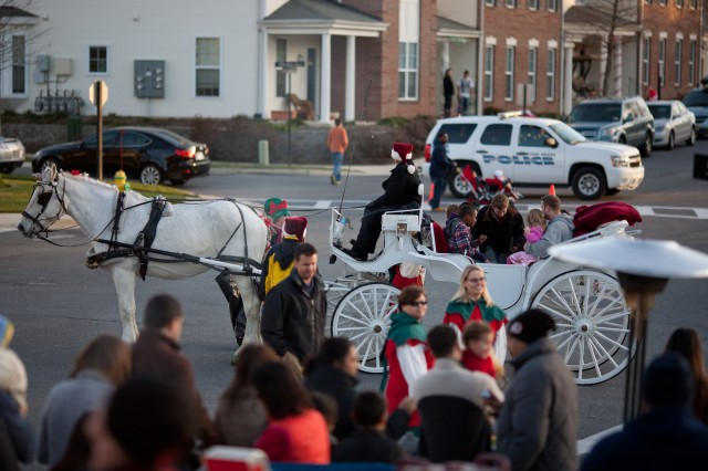 "Free rides in carriages drawn by light gray Percheron horses were a main attraction at ""December in the City"" at Potomac Neighborhood Center. Santa and Mrs. Claus arrived in their own horse-drawn carriage during the event."