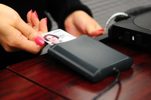 PRESIDIO OF MONTEREY, Calif. - As part of a pilot program, service members traveling out of Monterey Peninsula Airport may present their DOD identification, known as a CAC card, to the travel document checker at the checkpoint for scanning.