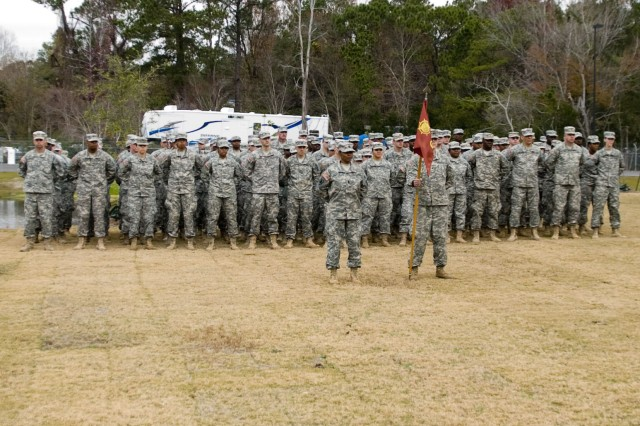 The 650th Transportation Company stands in formation in front of their new facility during the ribbon cutting ceremony in Wilmington, NC., Dec. 10, 2011.