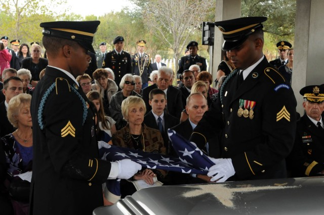 "FORT SAM HOUSTON, Texas "" Honor Guard members ceremonially fold the flag during the funeral interment for retired Gen. Ralph Haines Jr. at the Fort Sam Houston National Cemetery Dec. 3. The flag was then presented to retired Lt. Gen. Guy Swan III, the former commanding general of U.S. Army North and Fort Sam Houston, who presented the flag to William Haines, Gen. Haines' son."