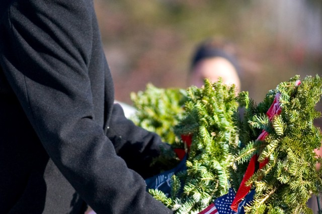 Alan Parks, manager, U.S. Army Garrison - Detroit Arsenal, lays a wreath as part of Wreaths Across America.
