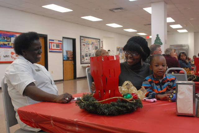 412th Theater Engineer Command Soldiers and family members celebrate the Holidays during Family Day at the George A. Morris Army Reserve Center Dec. 11, 2011 in Vicksburg, Miss. (Photo: Capt Maryjane Porter)
