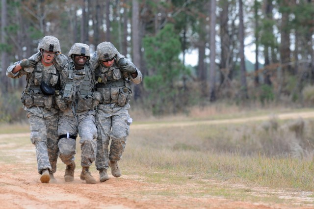 Pfc. Kevin M. Brown and Spc. Taton C. Mote,combat engineers assigned to Company A, 4-3 Brigade Special Troops Battalion, 4th Infantry Brigade Combat Team, 3rd Infantry Division, buddy carry Spc. Stephen D. Daniel during Sapper Stakes, Dec. 7, 2011, at Fort Stewart, Ga.