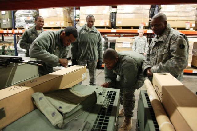 Army Reserve Soldiers from Arkansas and Virginia conduct preventative maintenance checks on equiment at the Equipment Storage Site Expanded (ESS-X). These Soldiers were participants in the two-week long Overseas Deployment Training active duty program from 1-17 November at the warehouse in Mannheim, Germany.   These Soldiers supplement the ESS-X workforce with maintenance and warehousing support.