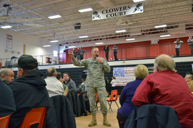Col. Eric P. Henderson, commander, 1st Space Brigade, addresses a crowd of veterans, service members, family members, and students at the 12th Annual Veteran's Breakfast on Dec. 5 at Peyton High School.