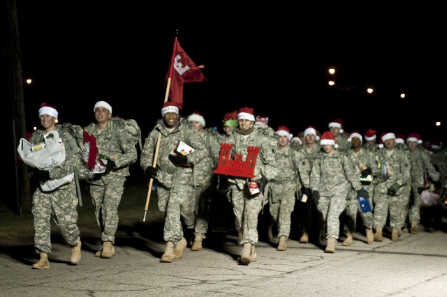 Members of the 19th Engineer Battalion march to Santa's Workshop during the unit's Santa's Helpers Road March on Dec. 2. During the road march, Soldiers donated toys carried in their ruck sacks to the American Red Cross, which helps military Families who are less fortunate.  (U.S. Army photo by Staff Sgt. Michael Behlin)