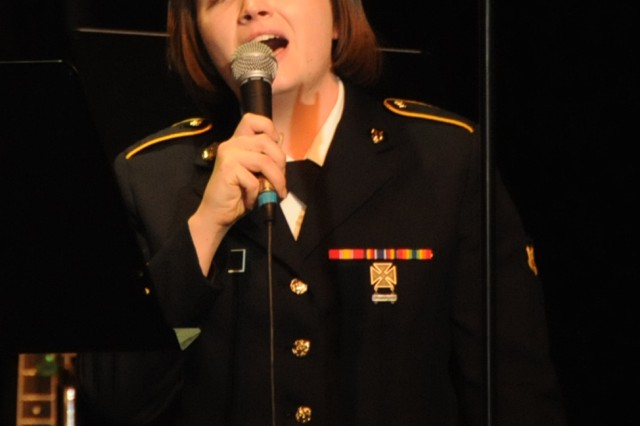 "The 208th Army Reserve Band performs its annual Holiday Concert at the Newberry Opera House in Newberry, S.C. on December 10. The band performed a variety of Christmas favorites much to the enjoyment of a full house. Pictured is french horn player Spc. Rachel Davis singing ""Have Yourself a Merry Little Christmas."""