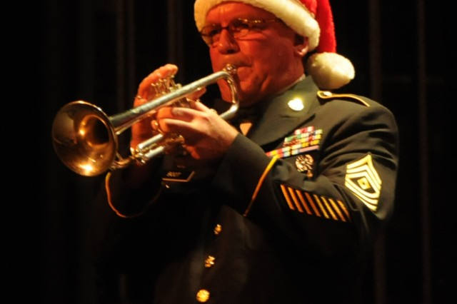 Santa's helper and 208th Army Reserve Band First Sgt. Curt Boot plays a trumpet solo during the annual holiday concert at the Newberry Opera House in Newberry, S.C. on December 10.
