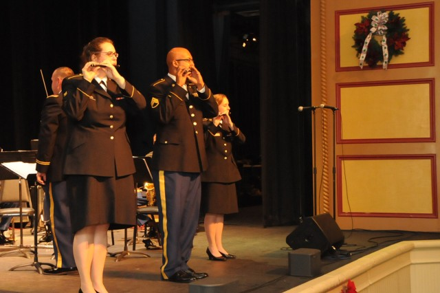The 208th Army Reserve Band performs its annual Holiday Concert at the Newberry Opera House in Newberry, S.C. on December 10. The band performed a variety of Christmas favorites much to the enjoyment of a full house. Pictured is french horn player Spc. Rachel Davis of Boone, N.C. who also sang a solo during the program.