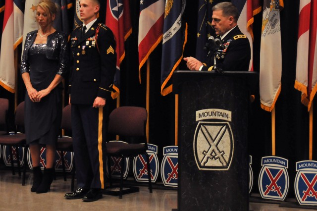 Maj. Gen. Mark A. Milley, Fort Drum and 10th Mountain Division (LI) commander, applauds Sgt. Jacob J. Perkins, who stands alongside his mother, Muriel, who flew in from Missouri for her son's award ceremony.