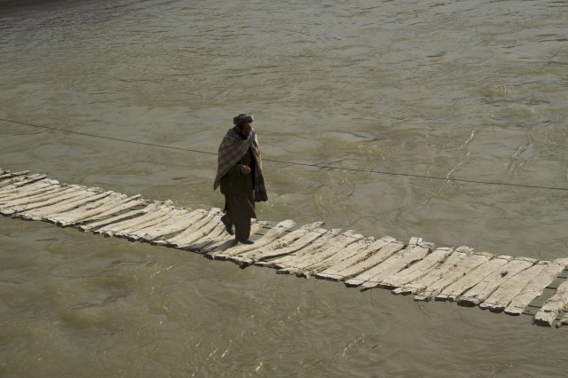 A villager makes his way across the bridge that connects Qasamabad village to Baghban village, Kajran district, Day Kundi province, Dec. 10.  The footbridge is the only one across the Varkdan River for at least seven kilometers.  Afghan National Army Special Forces and coalition Special Operations Forces assessed the condition of the bridge to determine possible ways to improve upon the structure.