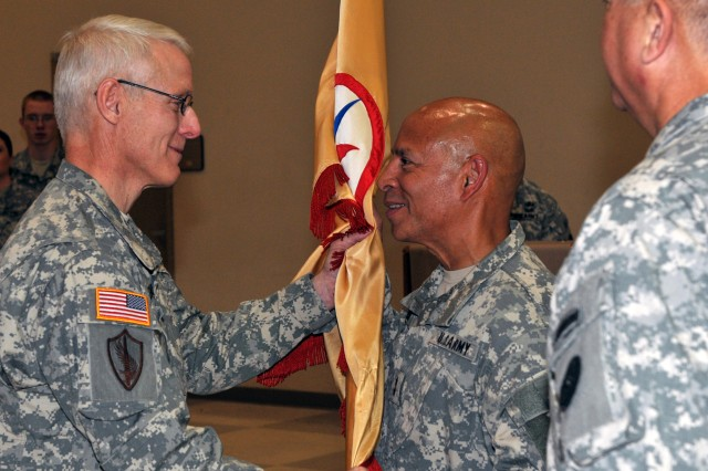 U.S. Army Brig. Gen. Peter Lennon (left), former commanding general of the 316th ESC, of Newport News, Va., transfers the colors of the 316th ESC to Maj. Gen. Luis R. Visot, commanding general of 377th TSC.
