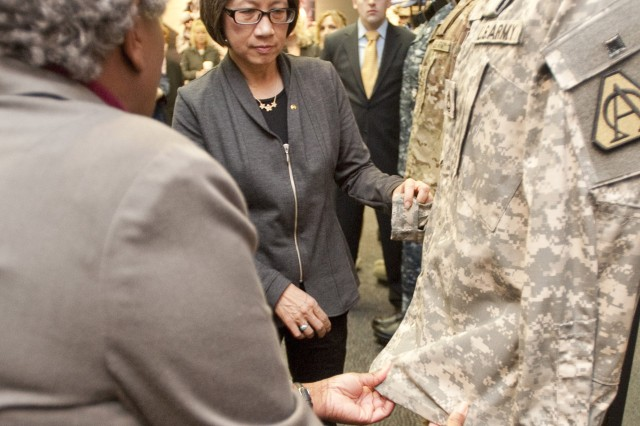 Heidi Shyu, Acting Assistant Secretary of the Army for Acquisition, Logistics and Technology, examines uniform technology during a Dec. 13 visit to the Natick Soldier Systems Center.
