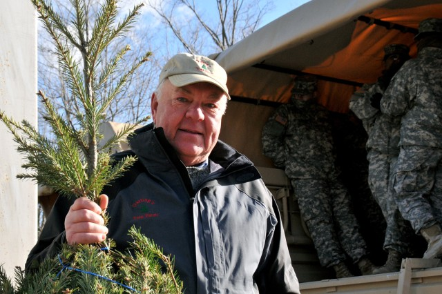 Dick Darling, owner of Darling's Tree Farm in Clifton Springs, poses with one of the live Christmas trees he donated to the Trees for Troops program Dec. 8, 2011. About 720 trees were delivered to Fort Drum, N.Y., from various tree farms for distribution to Fort Drum families.