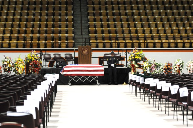 Lt. George Jackson, Virginia Tech police officer and Army veteran, posts watch over the casket of retired Staff Sgt. Deriek Crouse before his funeral on Dec. 12, at the Cassell Coliseum, on the Virginia Tech campus. Crouse's funeral was attended by soldiers from his unit and over 2,000 law enforcement personnel.