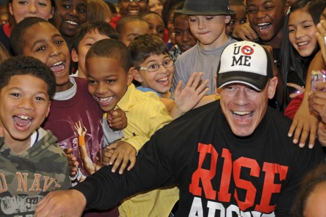 "John Cena, a World Wrestling Entertainer Superstar, promotes the WWE's ""Be a Star"" anti-bullying campaign at the Tolson Youth Activity Center at Fort Bragg, N.C., during the WWE's Superstars and Divas visit to Fort Bragg Dec. 9-10, 2011. More than twenty Superstars and Divas went around the post taking pictures and signing autographs for Soldiers and families leading up to their free ""Tribute to the Troops"" show Sunday evening at the Crowne Coliseum in Fayetteville, N.C. ""Be a Star!"" Cena cheered to the children as they roared back, ""Not a bully!"""