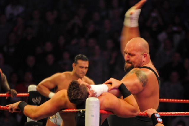 "World Wrestling Entertainment Superstar The Big Show slaps The Miz during the WWE's free ""Tribute to the Troops"" show Sunday evening at the Crowne Coliseum in Fayetteville, N.C. More than twenty Superstars and Divas went around Fort Bragg, N.C., taking pictures and signing autographs for Soldiers and families Dec. 9-10, 2011."