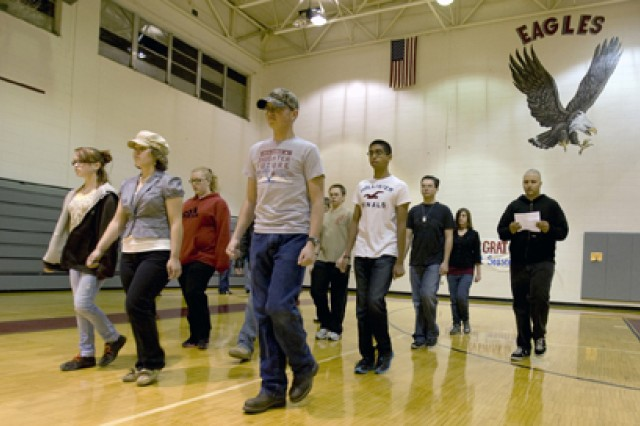 Without a gym to practice in at what is now the senior high school, members of the Joplin drill team run through marching movements during a 6:30 a.m. workout in a gym at what now houses Joplin's ninth- and 10th-grade students.