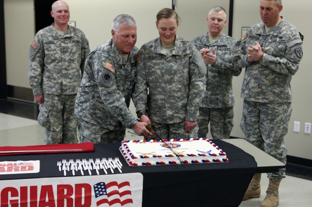 Maj. Gen. Myles Deering, Oklahoma National Guard Adjutant General, and Pvt. Jaqueline Schulze, 18, a recruit in basic combat training who will be assigned to the Maryland Army National Guard, cut the cake to celebrate the National Guard's 375th birthday Dec. 12 at the Armed Forces Reserve Training Center at Fort Sill. Schulze, of Bel Air, Md., is the youngest National Guard Soldier on post.