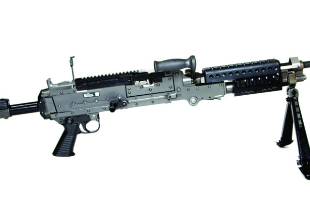 The M240L medium machine gun with short barrel and collapsible buttstock.