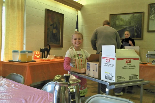 Grace Richter, daughter of 1st Sgt. Anthony Richter, Iron Mountain Recruiting Company, volunteers at an Iron Mountain community breakfast event with her father in October 2011.