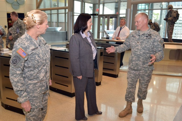 GEN Ann E. Dunwoody, Commander AMC, and COL Dan Williams give a tour of the new HQ AMC to The Honorable Ms. Katherine Hammack.