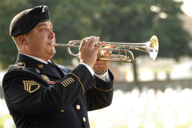 "Staff Sgt. Stefan Muldez from the 392nd Army Band performs ""Taps"" at Saturday's Wreaths Across America Ceremony in Hopewell."