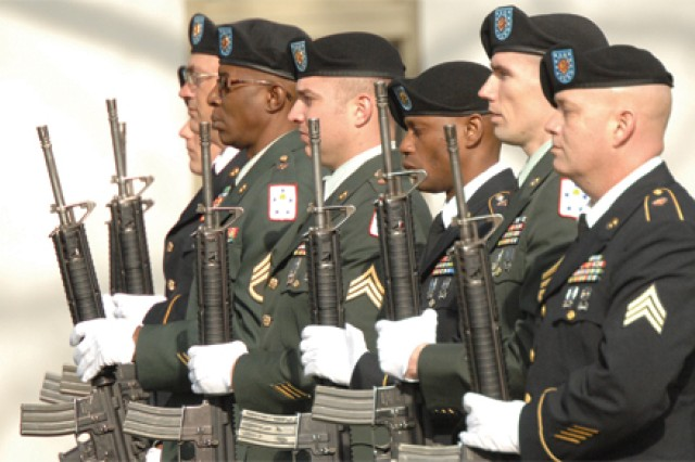 A rifle team from the 59th Ordnance Brigade salutes during the formal placement of wreaths at the ceremony. The team members included Sgt. 1st Class Jeeradech Daychapatormwan, Staff Sergeants Christopher Bushart, Roy Ramsden and Harlan Bryant, Sgt. Joseph Opyt, Staff Sergeants Corey Harvey and Benjamin Wise, and Sgt. Ron Dail. A multi-service color guard also participated. Its members included Sgt. 1st Class Marques Jones, Sgt. 1st Class Raymond Dukes, Staff Sgt. Gabriel Martinez, Marine Sgt. Joseph Galinak, Navy Petty Officer 1st Class Jacob Flickinger, Air Force Staff Sgt. Jason Reid and Marine Cpl. Oliver Hand.
