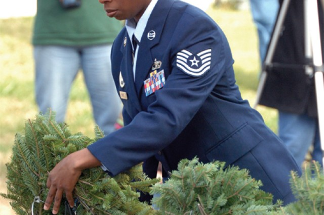 Tech. Sgt. Shaffiyah Curtis, 345th Training Squadron, participates in the formal wreath presentation during the observance.