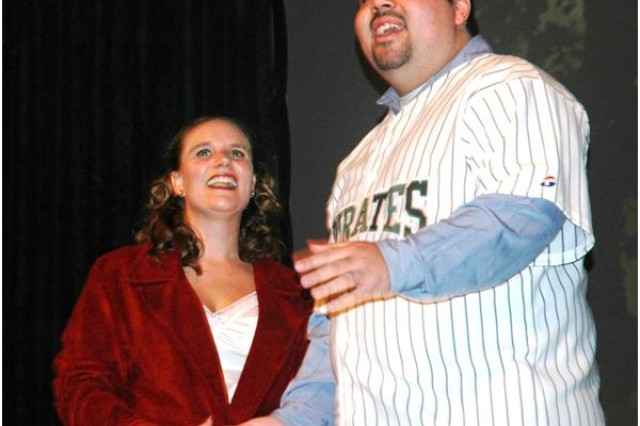 APG employees and volunteer actors (from left) Alyssa Buxbaum and Charlie Burgos-Lopez perform at the post theater Dec. 4.