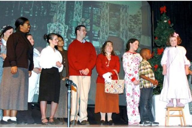 "The cast of ""It's A Wonderful Life"" gather onstage for the final scene of the Christmas classic at the post theater Dec. 4. The group will perform ""A Christmas Carol"" Dec. 19 at the APG North recreation center Dec. 19."