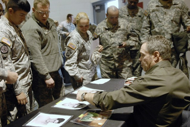 """Comedian Bernie McGrenahan speaks with Soldiers after performing his show """"Happy Hour -- Comedy With a Message,"""" at Howze Auditorium on Fort Hood, Texas, Dec. 2, 2011."""