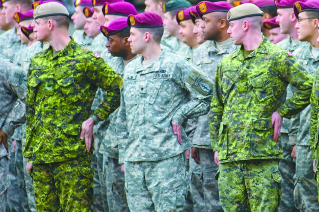 Soldiers from 1st Special Forces Group and the Canadian Special Operations Regiment form ranks at Joint Base Lewis-McChord, Wash., Dec. 5, 2011.