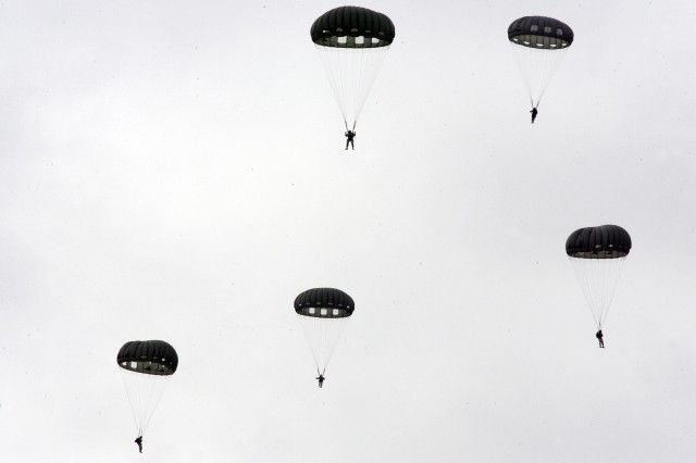 1st Specials Forces Group and Canadian Special Operations Regiment Soldiers participate in the annual jump Dec. 8, 2011, at Rogers Drop Zone on Joint Base Lewis McChord, Wash.